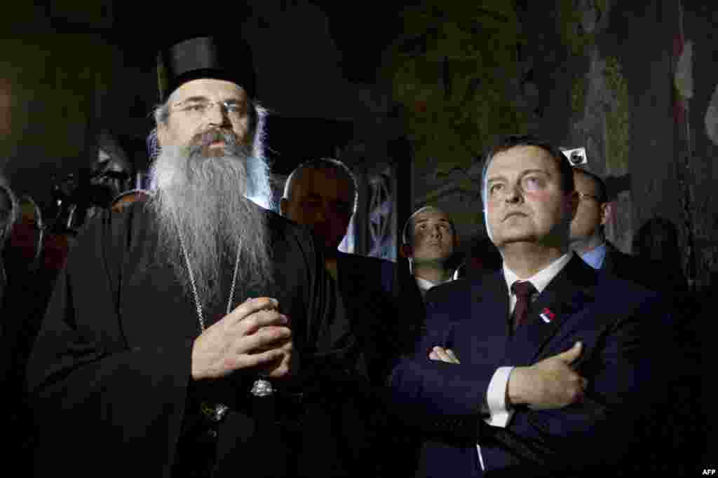 Serbian Prime Minister Ivica Dacic flanked by Archbishop Teodosie visits the Serbian Orthodox Monastery in Gracanica, central Kosovo, on October 19. (AFP)