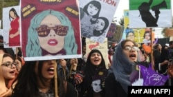 FILE: Pakistani women activists during a rally for women rights on International Women's Day in Lahore on March 8, 2019.