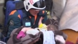 Russian Rescuers Pull Infant From Collapsed Building video grab