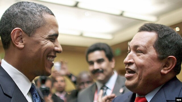 Venezuelan President Hugo Chavez (right) talks with his U.S. counterpart Barack Obama in Port of Spain.