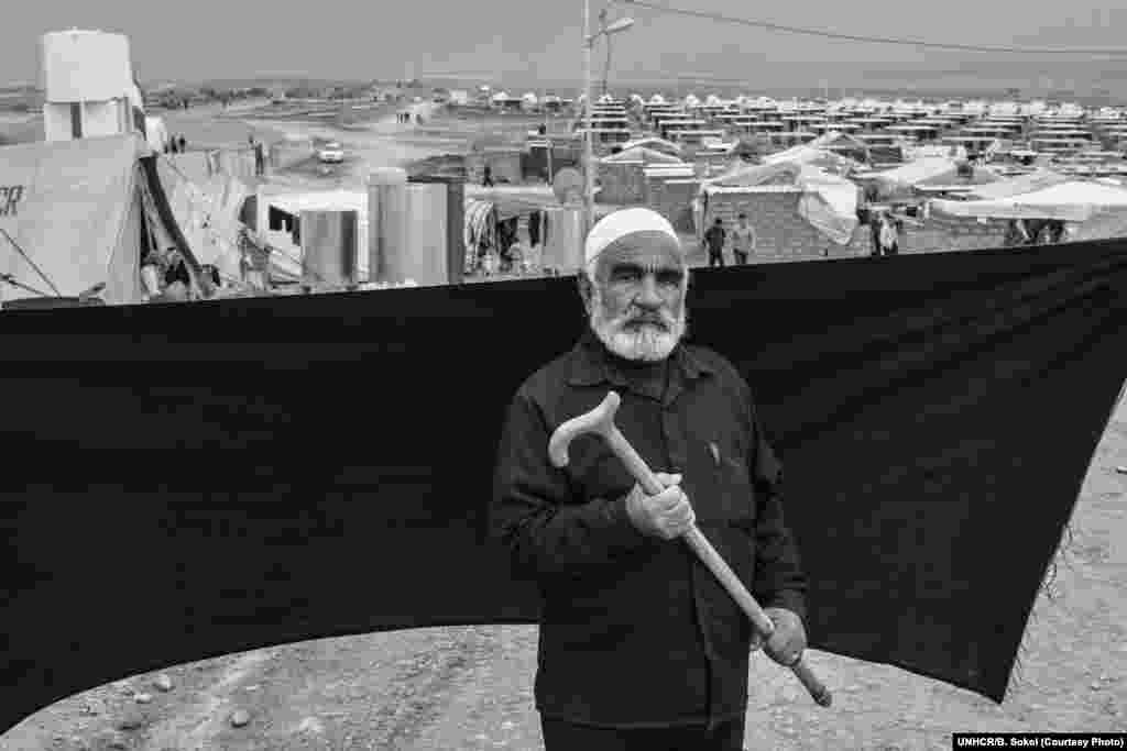"Ahmed, 70, fled Syria with his wife and eight of their nine children when their home in Damascus was destroyed in an attack. Together with four other families -- 50 people in all -- they escaped in the back of an open-topped truck, covered with plastic sheeting. The most important thing Ahmed brought is his cane, without which he wouldn't have made the two-hour crossing on foot to the Iraqi border. ""All I want now is for my family to find a place where they can be safe and stay there forever. Never should we need to flee again,"" he says."