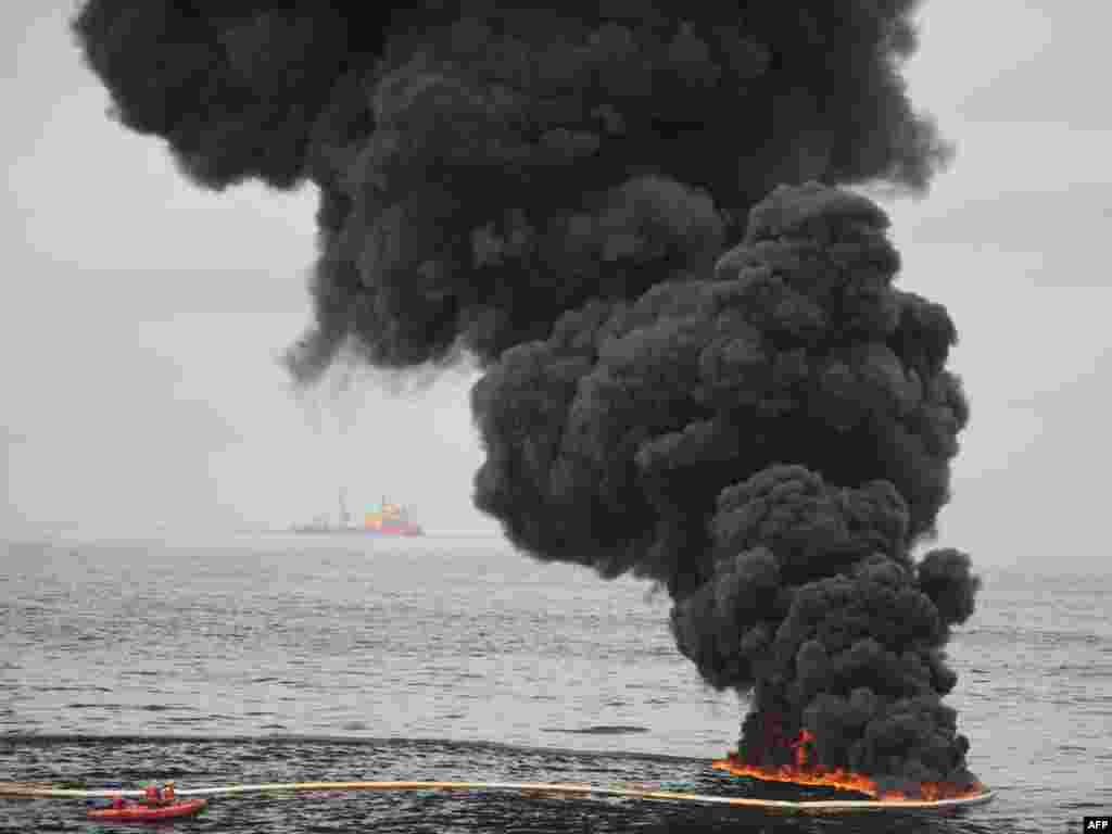 A controlled oil fire burns in the Gulf of Mexico, near the coast of Louisiana, where thousands of gallons of oil have leaked from the BP-operated Deepwater Horizon rig, causing massive environmental damage. Photo by Justin E. Stumberg for U.S. Department of Defense/AFP