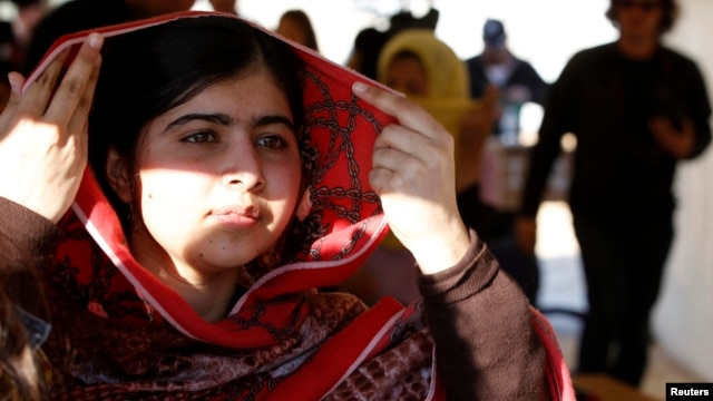 Pakistani teenage activist Malala Yousafzai leaves after speaking at a news conference at the Zaatri refugee camp, in the Jordanian city of Mafraq, near the border with Syria, in February.