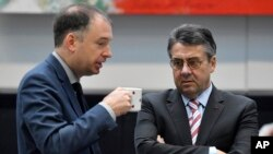 File Photo:German Foreign Minister Sigmar Gabriel (R), talks with member of the German Social Democrats (SPD) party, Niels Annen (L) during a sitting of the party's parliamentary group at the Bundestag in Berlin on January 22, 2018. - Centre-left Social Democrats vo
