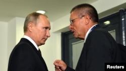 Russian President Vladimir Putin (left) listens to Economy Minister Aleksei Ulyukayev ahead of a meeting with Venezuelan President Nicolas Maduro in Istanbul, Turkey, on October 10.
