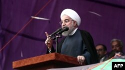 Iranian President Hassan Rohani addresses a campaign rally in the northeastern city of Mashhad on May 17.
