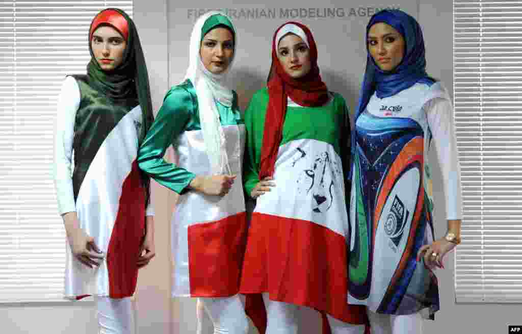 "Iranian models present outfits bearing the national flag's colors, the logo of the national soccer team, and the design of the WC2014 Brazuca balls during a fashion show organized by the House of Fashion and the ""Violet Models"" agency inTehran. (AFP/Bahareh Asadi)"