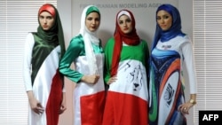 "Iranian models presenting outfits bearing the national flag's colors, the logo of the national football team and the design of the 2014 World Cup during a fashion show organized by the House of Fashion and the ""Violet Models"" agency in Tehran."