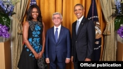 U.S. - President Barack Obama and First Lady Michelle Obama greet Armenian President Serzh Sarkisian during the United Nations General Assembly reception at the New York Palace Hotel in New York, 28Sept2015. (Official White House Photo by Lawrence Jackso