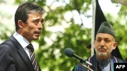 Fogh Rasmussen (left) with Afghan President Hamid Karzai in Kabul, where NATO has a high-priority mission to defeat militants and deliver security.