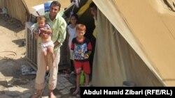 لاجئون سوريون في مخيم دوميز قرب دهوك