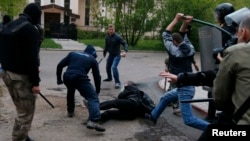 Pro-Russian militants attack a pro-Ukranian protester during a pro-Ukraine rally in the eastern city of Donetsk on April 28.