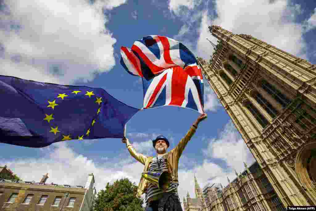 A pro-European Union demonstrator protests outside Parliament in central London against the first vote on a bill to end Britain's membership in the EU. (AFP/Tolga Akmen)