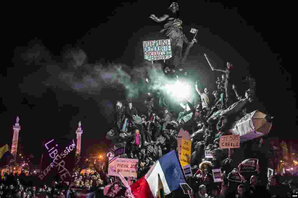 Second Prize in the Spot News category was won by French freelance photographer Corentin Fohlen for this image of a demonstration against terrorism in Paris. The protest was staged in the wake of the Charlie Hebdo attacks. (January 11, 2015)