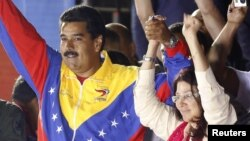 Prezident Nicolas Maduro və arvadı Cilia Flores (Foto arxivdəndir)