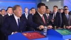 Chinese President Xi Jinping (right) and Kazakh counterpart Nursultan Nazarbaev turn a symbolic lever during an opening ceremony of the new container service between western China and Western Europe in Astana in June.