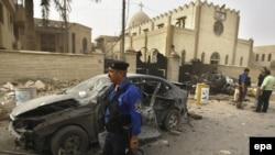 شرطي يحرس كنيسة في شارع فلسطين ببغداد