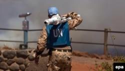 Член миротворчої місії ООН біля сирійсько-ізраїльського кордону в районі Голанських висот. Сирія, серпень 2014 року