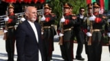 Afghan President Ashraf Ghani inspects the honor guard during Independence Day celebrations at Defense Ministry in Kabul on August 19.