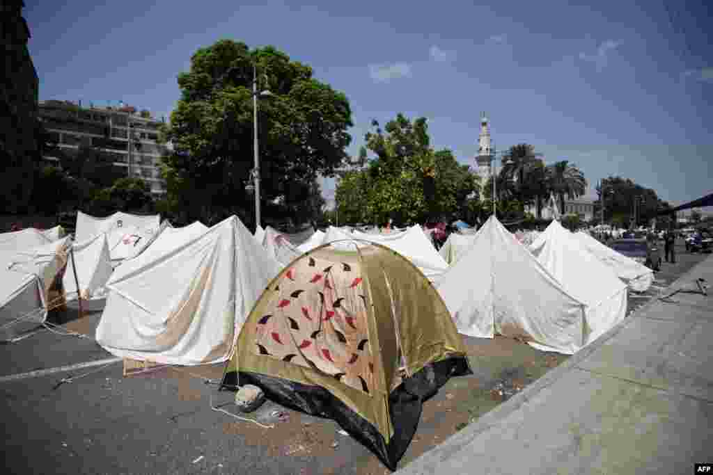 Protesters have set up tents to stake out their positions outside the presidential palace in Cairo.
