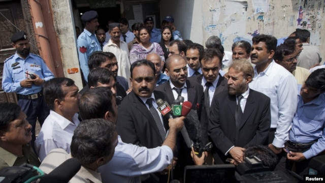Tahir Naveed Chaudhry (left), a lawyer for Rimsha Masih, a Christian girl accused of blasphemy, speaks to the media along with other lawyers after he appeared before a judge at the district court in Islamabad on September 3.