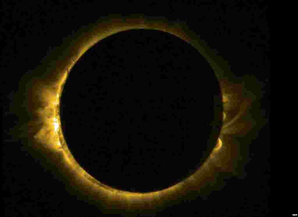 Space -- A solar eclipse is viewed by ESA's Sun-watching Proba-2 minisatellite, using it's SWAP imager to capture the Moon passing in front of the Sun in a near-totality, March 20, 2015