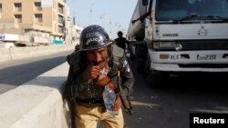 Карачидеги полиция кызматкери
