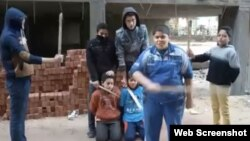 "A screen grab from the video of Egyptian children carrying out a mock ""execution."" The video has circulated widely on social media."