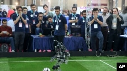 A humanoid robot of Iranian students from Amir Kabir university plays in a soccer match during the international robotics competition, RoboCup Iran Open 2016, in Tehran, Iran, Wednesday, April 6, 2016. The event, organized by Iranian RoboCup Regional Comm