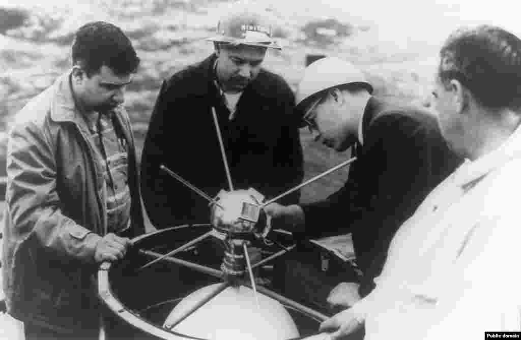 "A Vanguard satellite being fitted to its rocket. Dismissed as the ""grapefruit"" by Soviet leader Nikita Khrushchev, America was playing catch-up with its Vanguard program in the wake of the Soviets' launch of Sputnik 1. After two fiery failures, the 1.5-kilogram space ball was finally popped into orbit in 1958."
