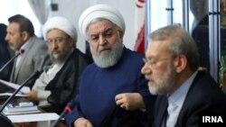 Head of Iran's Judiciary, Sadegh Larijani (left), Iranian President Hassan Rouhani, and Speaker of Parliament Ali Larijani. August 14, 2018.
