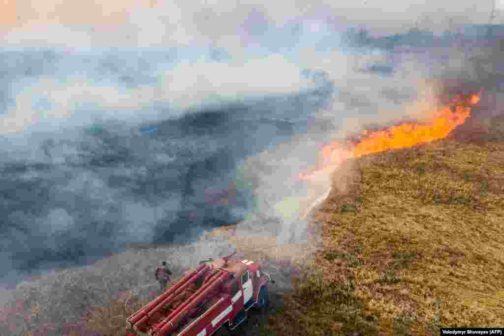 Nearly 100 firefighting vehicles were being used to battle the wildfires.