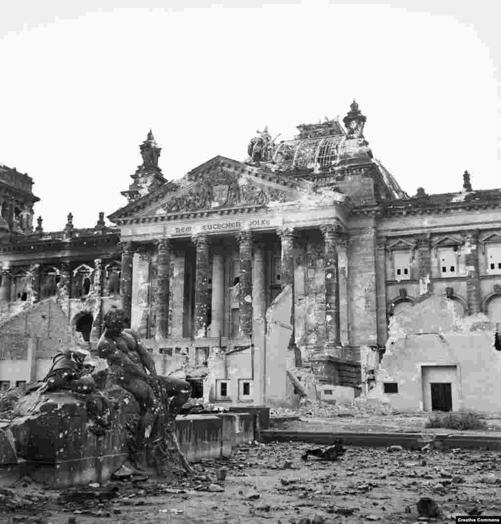 The flame and shrapnel-scarred Reichstag   By the end of the war, Berlin's population plummeted, largely due to people fleeing the advancing Soviet troops.