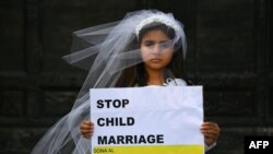 ITALY -- A young actress plays the role of Giorgia, 10, forced to marry Paolo, 47, during a event organized by Amnesty International to denounce child marriage, on October 27, 2016 in Rome.
