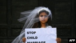 ITALY -- A young actress plays the role of Giorgia, 10, forced to marry Paolo, 47, during a happening organised by Amnesty International to denounce child marriage, on October 27, 2016 in Rome.
