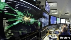 A graphic shows a collision at full power in a control room of the Large Hadron Collider (LHC) at the European Organization for Nuclear Research (CERN) in Switzerland. (file photo)
