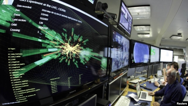 A graphic shows a collision at full power is pictured at the Compact Muon Solenoid (CMS) experience control room of the Large Hadron Collider (LHC) at the European Organization for Nuclear Research (CERN) in Meyrin in March.