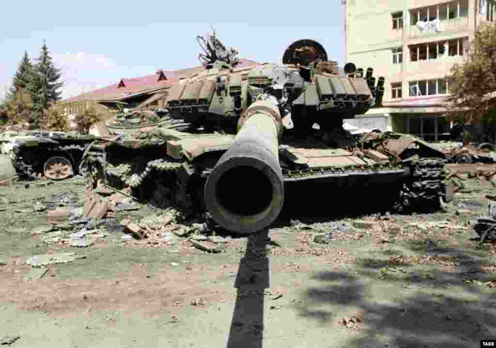 A destroyed Georgian tank sits among the ruins of Tskhinvali on August 14. Russian and Georgian officials reached a cease-fire plan on August 12, which would be signed by the South Ossetian and Abkhaz leaders two days later.