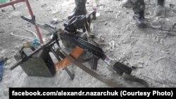 """Трофейное оружие и боеприпасы, захваченные военными на шахте """"Бутовка"""" у сепаратистов"""
