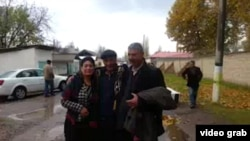 Murod Juraev (center) after his release from prison