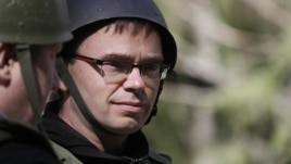 Estonian Defense Minister Sven Mikser observes a military drill in May.