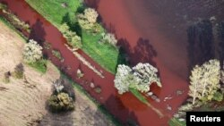 An aerial view shows a toxic red sludge spill from an alumina plant near Ajka, Hungary, on October 7.