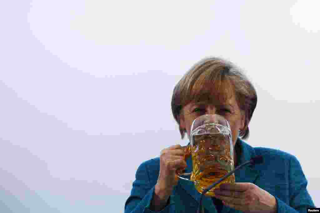 Angela Merkel drinks a beer after her speech in a beer tent in Munich in May 2013.