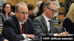 President on FATF, Marshall Billingslea (L) at day one of the FATF Plenary under U.S. presidency in Paris on October 17, 2018.