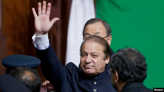 Pakistani Prime Minister Nawaz Sharif waves to the crowd after attending a flag raising ceremony to mark the 66th anniversary of the country's independence on August 14.