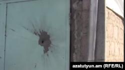 Ворота гаража, поврежденные в результате обстрела азербайджанских снайперов, село Мовсес Тавушской области Армении, август 2014 г.