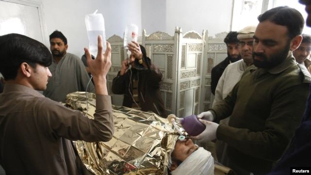 An antipolio campaign worker, Hilal Khan, who was shot and badly injured by unidentified gunmen, receives treatment at Lady Reading Hospital in Peshawar on December 19.