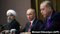 Russian President Vladimir Putin (C), Turkish President Recep Tayyip Erdogan (R) and Iranian President Hassan Rouhani address the media after a trilateral meeting on Syria in Sochi on November 22, 2017