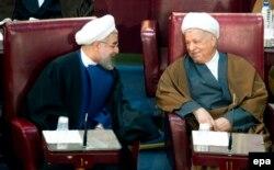 Президент Ирана Хасан Роухани с бывшим президентом Ирана Акбаром Хашеми Рафсанджани. Тегеран, 4 марта 2014 года.
