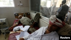 Wounded men receive treatment, after the blast in Jalalabad.